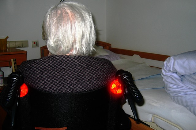 Elderly woman in wheelchair.