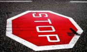 stop sign painted onto street
